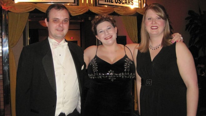 From left, Jason and Marlene Boshears of Franklin and Charlsi Legendre of Spring Hill enjoy the Oscars-themed 2010 Legacy Ball. Now named the Button Ball, this year's event is March 3.