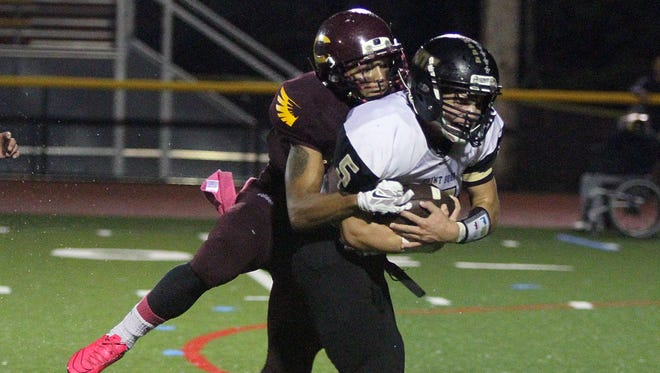 The Point Pleasant Boro Panthers traveled down the Garden State Parkway to take on the Central Regional Golden Eagles in a varsity high school football game on Friday October 9, 2015.Here Pt Pleasant Boro's # 5 (right) Nate Husak is tackled by Central Regional's # 5 (left)- Michael Miserendino.