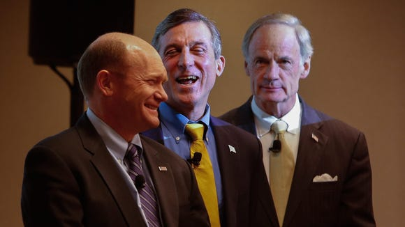 Sen. Chris Coons, Rep. John Carney and Sen. Tom Carper join hundreds of Cigna employees to mark the passage of the Expatriate Health Coverage Clarification Act, which helped protect 500 Delaware jobs.