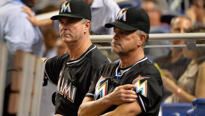 Marlins manager Dan Jennings, left, has gotten off to a rough start, losing seven of his first 10 games.
