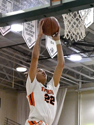 Fern Creek's Chance Moore (22) goes uo for a dunk during the second half of the Mitchell Irvin Tournament, Thursday, Dec. 29, 2016 in Crestwood KY.