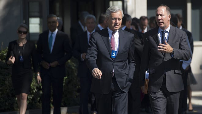 John Stumpf (left), president and CEO of Wells Fargo, and Rob Nichols, president and CEO of the Financial Services Forum, arrive for a meeting of the Financial Services Forum with President Barack Obama at the White House in Washington, D.C., Oct. 2, 2013, on the second day of the government shutdown.