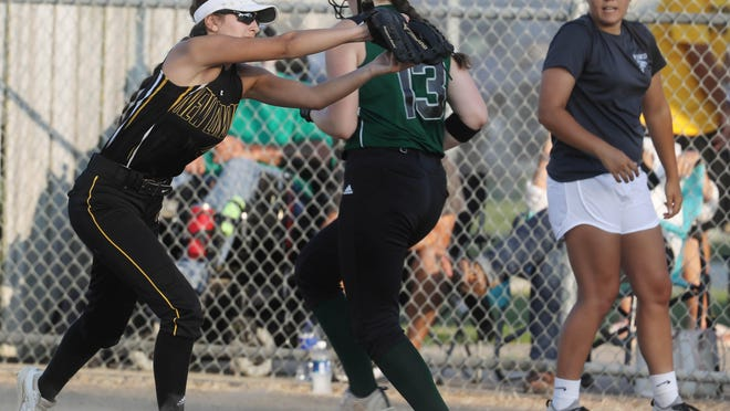 West Burlington-Notre Dame's Elise Oleson (13) safely crosses first as Marah Hartrick (4) misses the ball during their game against New London High School,  Wednesday July 8, 2020 in New London.