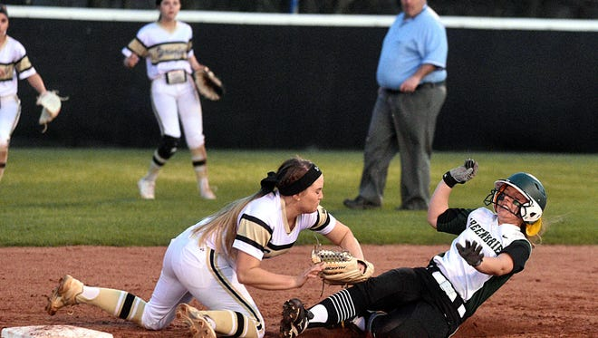 Springfield's Morgan Clark tags out Greenbrier's Abbi Murphy at second base during Thursday's White House jamboree.