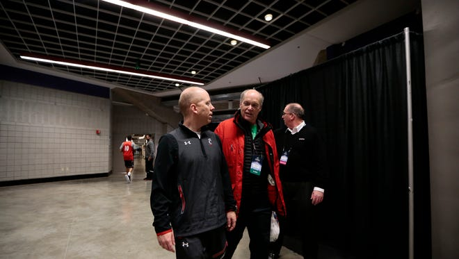 Cincinnati Bearcats head coach Mick Cronin heads to the locker room after open practice at Spokane Arena in Spokane, Wash., on Thursday, March 17, 2016. The Bearcats take on the Saint Joseph's Hawks in the second round of the NCAA Tournament Friday night.