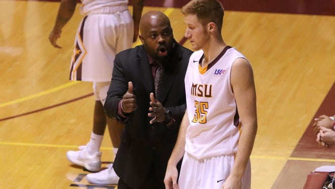 Midwestern State head men basketball coach Nelson Haggerty talks to Nick Powell in the game against Cameron Tuesday, Jan. 17, 2017, in D.L. Ligon Coliseum at MSU. The Aggies defeated the Mustangs 83-74.