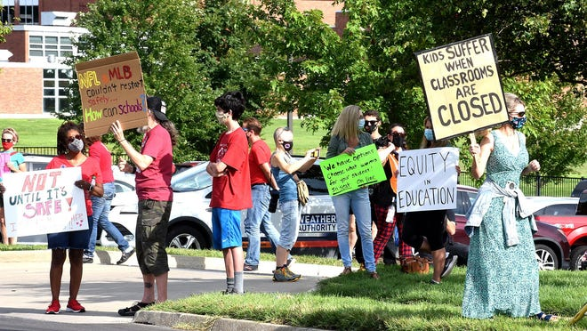 About 100 people protested Tuesday outside the Columbia Board of Education meeting where members discussed when to reopen schools.