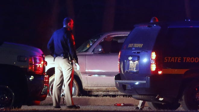 Police investigate early Sunday in in Rogers Manor Park near New Castle after a shooting that left one man in critical condition and a second injured.