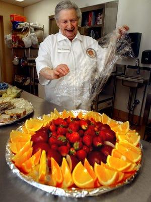 Eva Winston prepares food at the York Jewish Community Center March 5, 2002.