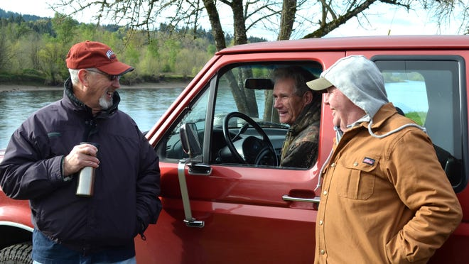 Pat Mcdermott of Keizer (from left), Gene O'Day of Independence and Leon Kitchin of Dallas share fish tales and a laugh at the Social Security Hole.