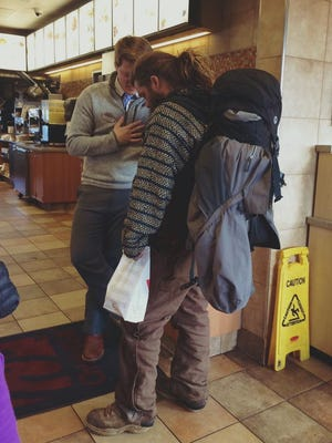 Chick-Fil-A manager Josh Stouts shares food and prayer with Justin Burkeen in a Facebook post that has gone viral.