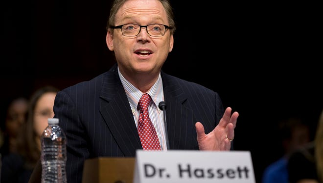 """Kevin Hassett, senior fellow and director of Economic Policy at the American Enterprise Institute (AEI), gestures as he testifies on Dec. 6, 2012, Capitol Hill in Washington before the Joint Economic Committee hearing entitled: """"Fiscal Cliff: How to Protect the Middle Class, Sustain Long-Term Economic Growth, and Reduce the Federal Deficit."""" The analysis by Hassett, President Donald Trump's chief economist, estimated Monday, Oct. 16, 2017, that the administration's plan to cut corporate tax rates will cause average household incomes to jump $4,000 a year - a stunning 5 percent increase that could be met with skepticism among tax experts and Democratic lawmakers."""