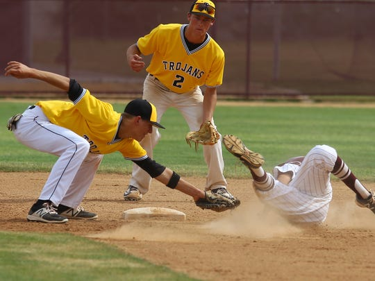 Yucca Valley/s Zachary Schoenbor applies a tag on Rancho