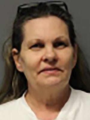 Katherine Herbert, 57, of Peeples Valley, Ariz., faces a charge of first-degree murder after her husband was shot and she waited three days before telling sheriff's deputies.