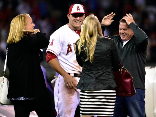Mike Trout of the Los Angeles Angels celebrates with his family after being named MVP.