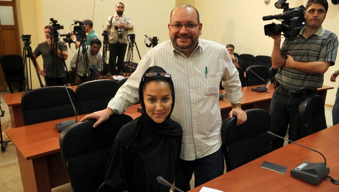 """Washington Post"" Iranian-American journalist Jason Rezaian and his Iranian wife, Yeganeh Salehi, at a newsconference in Tehran, Iran."