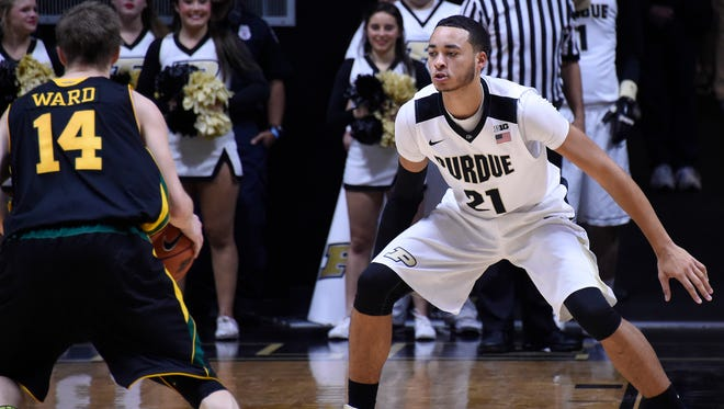 Purdue guard Kendall Stephens (21) defends against Vermont in the first half at Mackey Arena.