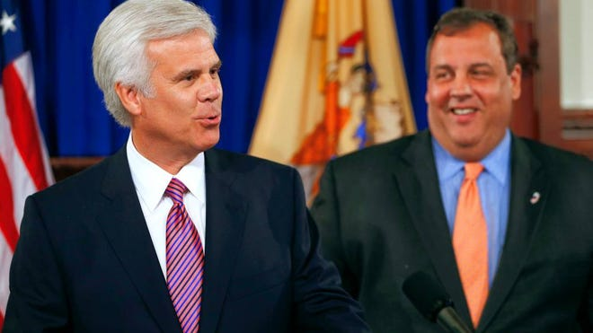 George E. Norcross III, left, and Gov. Chris Christie in a 2013 photo.