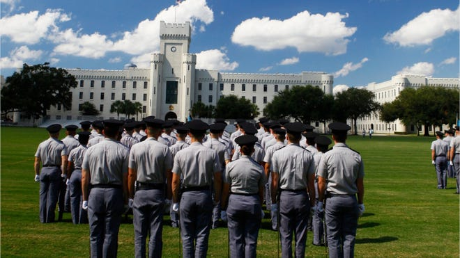 Citadel cadets at attention in front of the Padgett-Thomas Barracks.