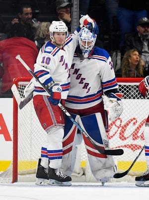 Rangers left wing J.T. Miller, left, congratulates goalie Antti Raanta, of Finland, after the Rangers defeated the Los Angeles Kings 3-0 in an NHL hockey game, Saturday, March 25, 2017, in Los Angeles.