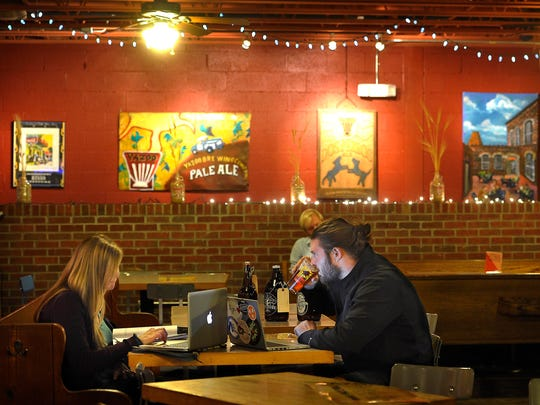 Caroline Carter and Mitchell Greene enjoy a local craft beer at Yazoo's taproom.