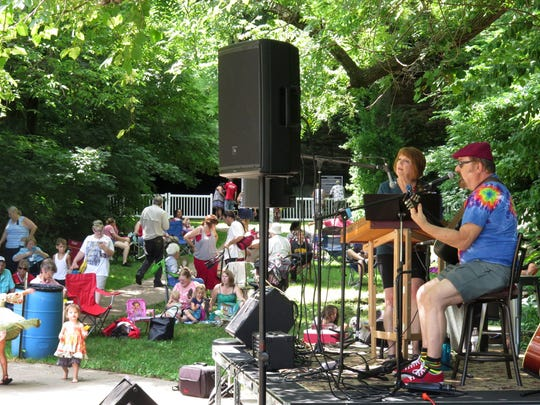 The Red Shoe Pickers perform at the Doling Neighborhood Association's Concert at the Cave event last July at Doling Park. The neighborhood association used Facebook to promote the event which had 500-600 people at the first-year event.
