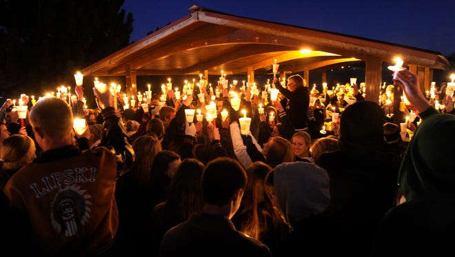 Hundreds of Arapahoe High School students gather for a candlelight vigil Dec. 14  to pray for Claire Davis, who was shot inside the school the previous day.