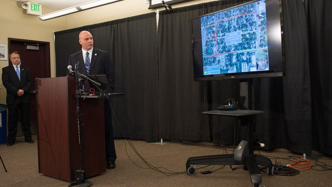 Larimer County Sheriff's Office spokesperson David Moore shows surveillance video of a truck connected to a string of shootings that have occured around Northern Colorado during a press conference at the Budweiser Events Center in Loveland Tuesday, April 26, 2016.