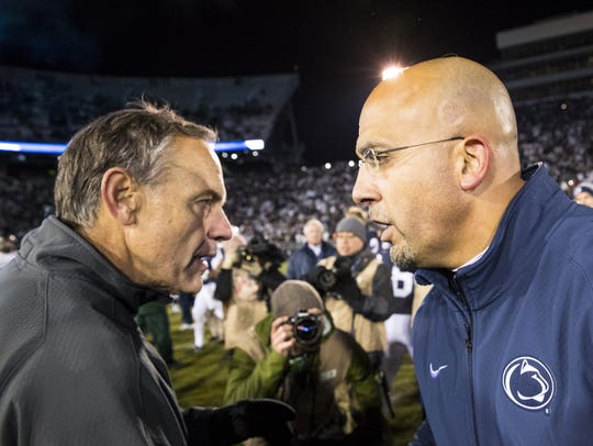 Michigan State coach Mark Dantonio shakes hands with Penn State coach James Franklin after MSU's 45-12 loss in 2016.