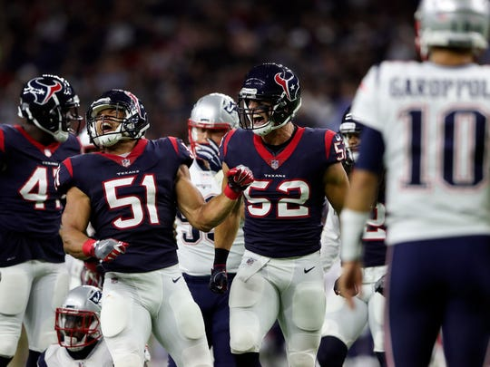 Houston Texans linebacker Dylan Cole (51) and linebacker Brian Peters (52) react in front of New England Patriots quarterback Jimmy Garoppolo (10) during a preseason game at NRG Stadium
