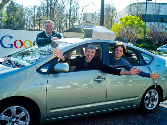 From left: Eric Schmidt, Larry Page and Sergey Brin