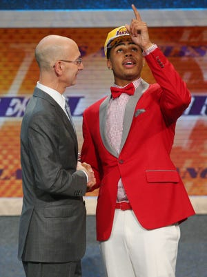 D'Angelo Russell (Ohio State) shakes hands with NBA commissioner Adam Silver after being selected as the No. 2 overall pick to the Los Angeles Lakers in the first round of the 2015 NBA Draft at Barclays Center.