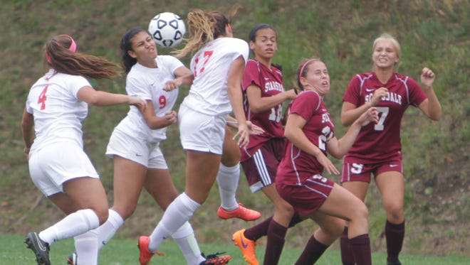 North Rockland sophomore Daniella Devaney (9) heads the ball during a set piece in the offensive third during a game against Scarsdale at North Rockland High School on Saturday, September 12th, 2015. North Rockland won by a 2-0 score.
