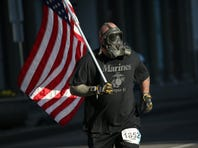 Darth Vader, 44, of Canandaigua runs the Flower City Half Marathon in April, 2016.