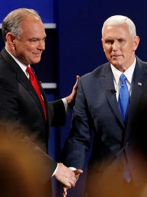 Republican vice-presidential nominee Gov. Mike Pence, right, and Democratic vice-presidential nominee Sen. Tim Kaine shake hands after the vice-presidential debate at Longwood University in Farmville, Va., Tuesday evening.