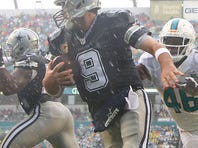 Tony Romo #9 of the Dallas Cowboys in action during the first quarter of the game against the Miami Dolphins at Sun Life Stadium on November 22, 2015.