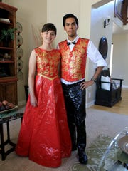 Lauren Gardner and Ruben Taylor display their duct tape prom outfits at Gardner's home in Hurricane.
