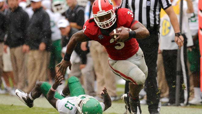 Georgia running back Todd Gurley (3) breaks a tackle by North Texas defensive back James Jones (13) during the second half last Saturday at Sanford Stadium. Georgia is outside the top four of the Football Four Playoff Projection, but a win this week against LSU would merit greater consideration.