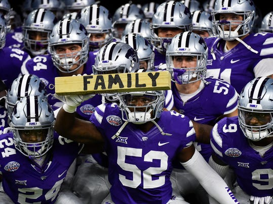 Kansas State linebacker Charmeachealle Moore (52) and teammates prepare to take the field for the Texas Bowl NCAA college football game against Texas A&M, Wednesday, Dec. 28, 2016, in Houston. (AP Photo/Eric Christian Smith)