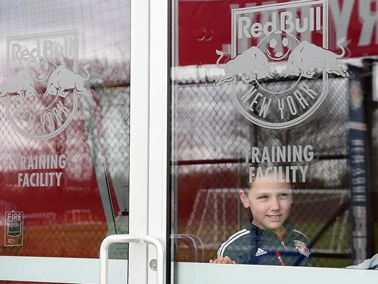 Julia, 9, waits for the Red Bulls team practice to