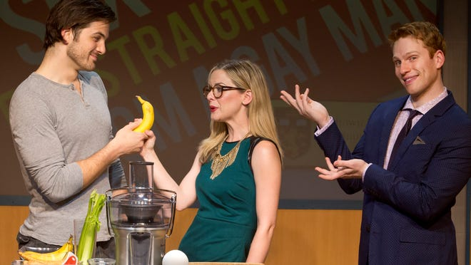 """A stage assistant (played by Keith Hines) and an English professor named Robyn (Rachel Moulton) work through a hands-on lesson from a visiting author (Grant McDermott) in """"Sex Tips for Straight Woman from a Gay Man,"""" which opens Tuesday in Des Moines."""