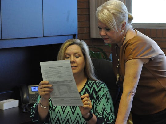 Natalie Brown (left), a detective with the Rapides Parish Sheriff's Office, and Melanie Millet, victims assistance coordinator for the District Attorney's Office, are shown working at The Family Justice Center of Central Louisiana.
