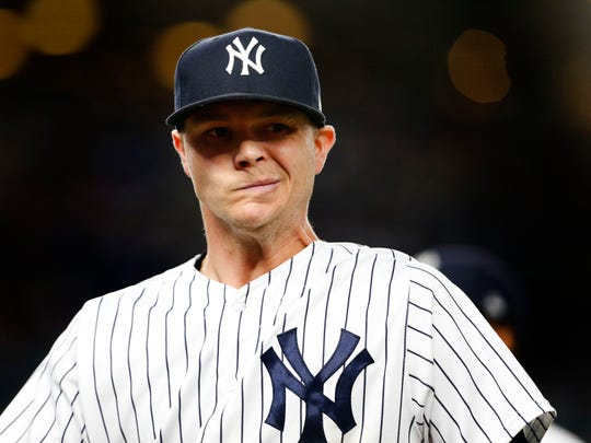 New York Yankees starting pitcher Sonny Gray (55) reacts on his way to the dugout in the fourth inning against the Oakland Athletics at Yankee Stadium.