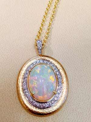 This necklace by Kathy Zaltas is made from diamonds and an opal re-purposed from an older cocktail ring.