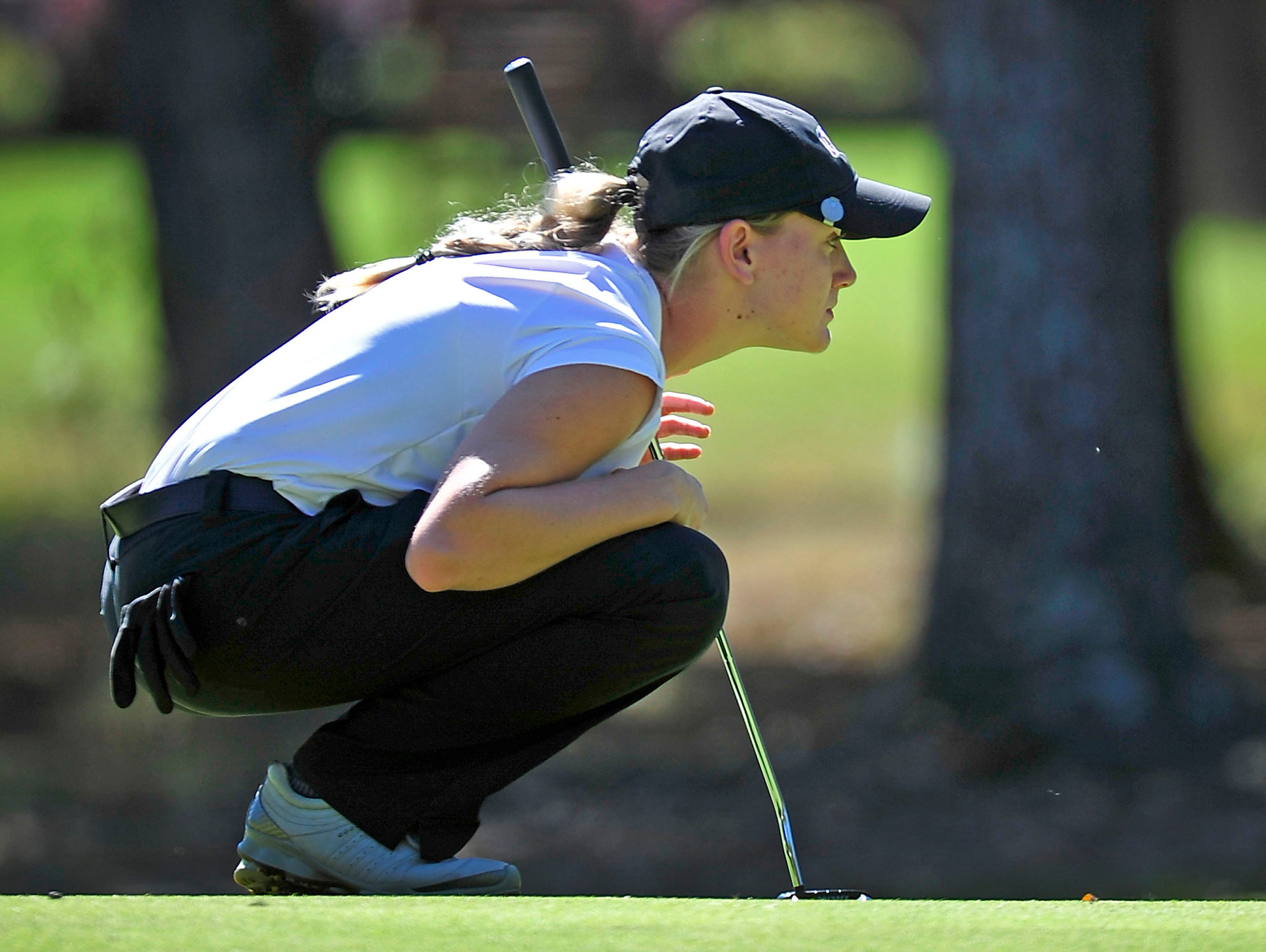 CPA's Siarra Stout looks at a putting line on the 11th green during the Class A/AA State Golf Tournament at WillowBrook Golf Club in Manchester, Tenn., Wednesday, Oct. 14, 2015.