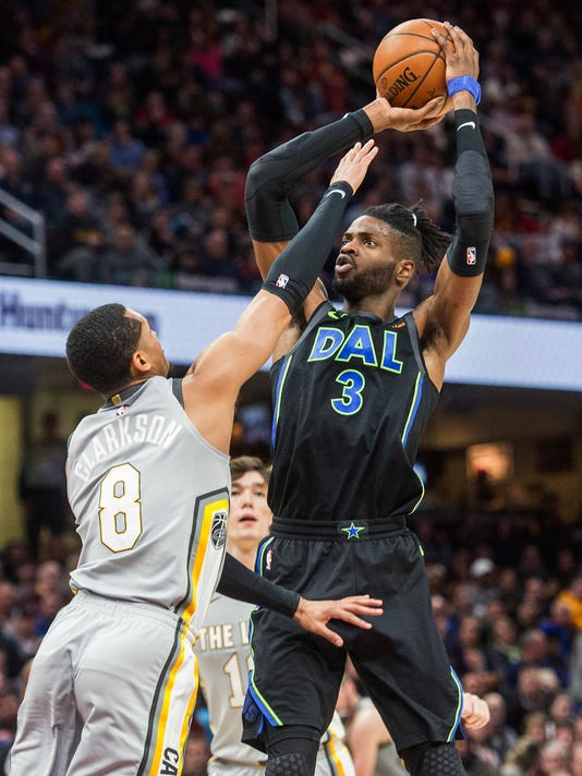 Dallas Mavericks' Nerlens Noel (3) shoots over Cleveland Cavaliers' Jordan Clarkson (8) during the second half of an NBA basketball game in Cleveland, Sunday, April 1, 2018. The Cavaliers won 98-87. (AP Photo/Phil Long)