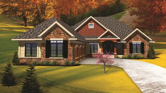 Here's a clever way to downplay a three-car garage: turn it to the side! This elevation draws your eye instead to the entry with graceful columns.
