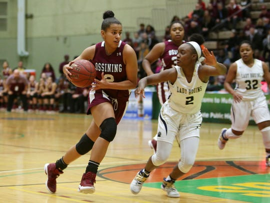 Ossining's Andra Espinoza-Hunter drives to the basket in front of Baldwin's Aziah Hudson (2) during the girls Class AA state championship game at Hudson Valley Community College in Troy March 18, 2017.