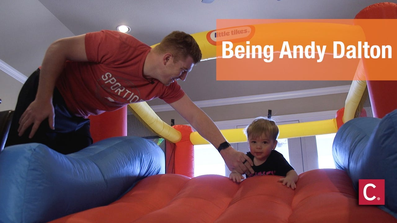 He's the Bengals' quarterback. But at home, he's a father, husband, brother and son.