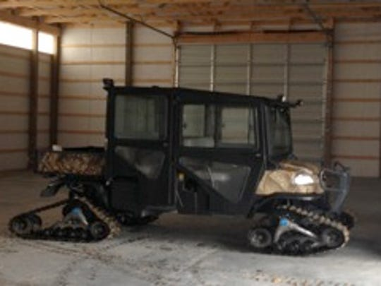 2013 Kubota RTV 1140CA Camo/black with enclosed metal cab and after market Camoplast track system.